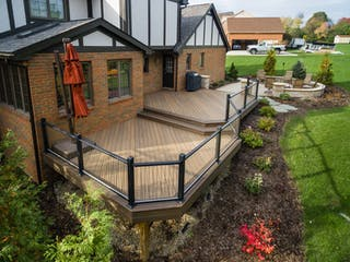Custom North Royalton composite deck with vertical cable railings